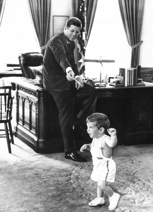 JOHN F KENNEDY PLAYS WITH SON JOHN IN THE OVAL OFFICE