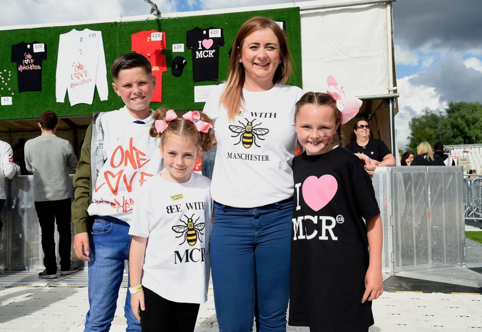 Fans pose ahead of the One Love Manchester benefit concert for the victims of the Manchester Arena terror attack at Emirates Old Trafford, Manchester