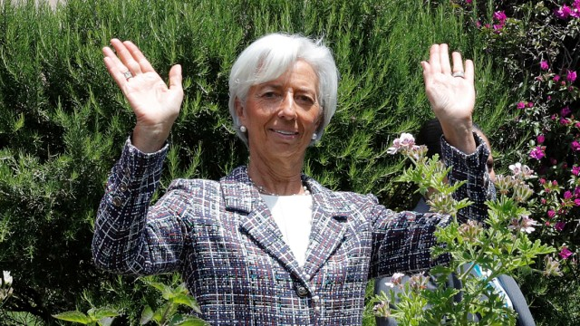 Christine Lagarde, head of the International Monetary Fund (IMF), reacts after an expanded session family photo at the G7 Summit in Taormina