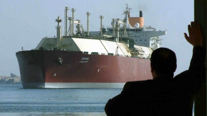 FILE PHOTO - A man looks as the world's biggest LNG tanker DUHAIL as she crosses through the Suez Canal