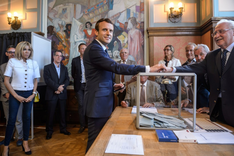 French President Emmanuel Macron casts his ballot to vote in parliamentary elections in Le Touquet