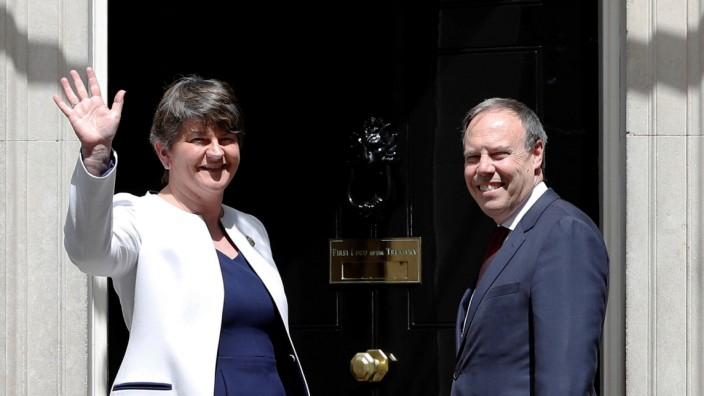 The leader of the Democratic Unionist Party, Arlene Foster, and the Deputy Leader Nigel Dodds, stand on the steps of 10 Downing Street before talks with Britain's Prime Minister Theresa May, in central London