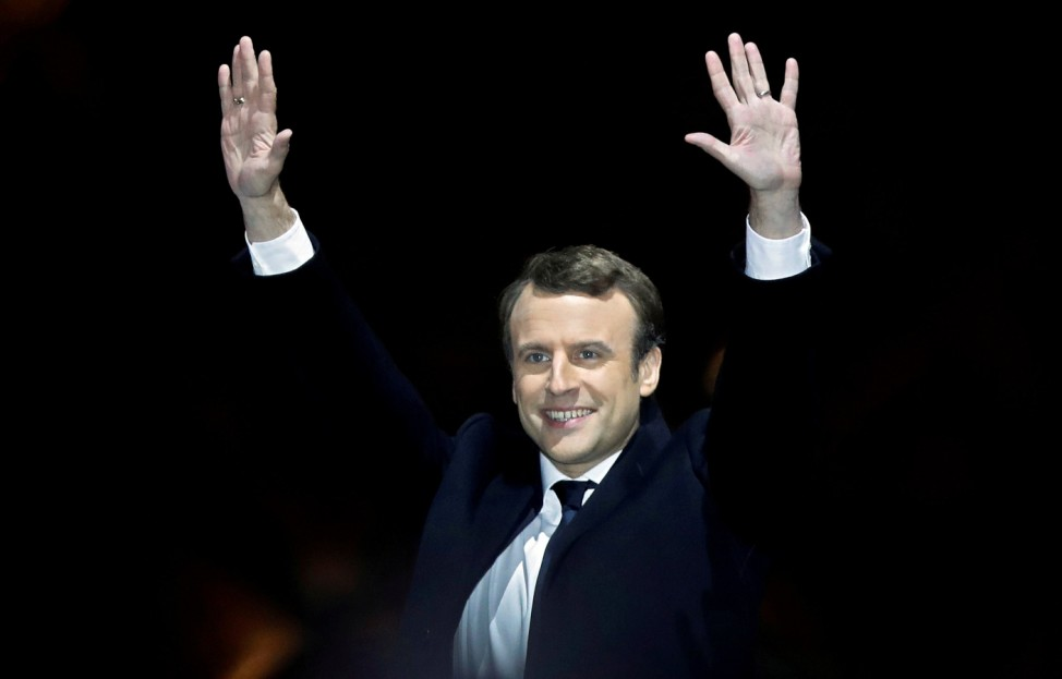 FILE PHOTO: French President-elect Emmanuel Macron celebrates on the stage at his victory rally near the Louvre in Paris