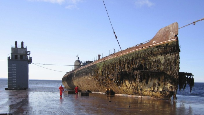 Murmansk region, russia, september 08, 2006, the decommissioned nuclear-powered submarine k-60 with a reactor aboard is transported on the dockwise (dutch heavy lift shipping company) semi-submersible vessel transshelf from the gremikha naval base to