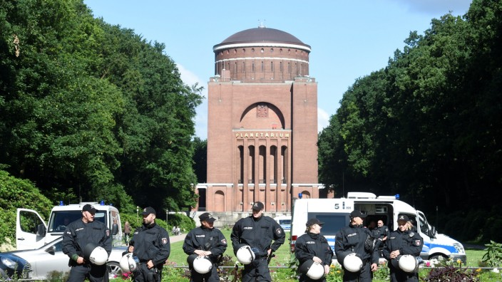 Police forces guard the scene during a G20 demonstration against the ban of Hamburg's authorities of a G20 protestors camp in the Stadtpark park in Hamburg
