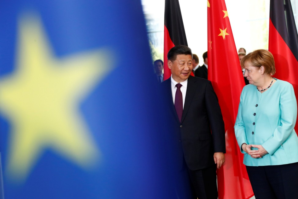 German Chancellor Angela Merkel and Chinese President Xi Jinping attend a contract signing ceremony at the Chancellery in Berlin