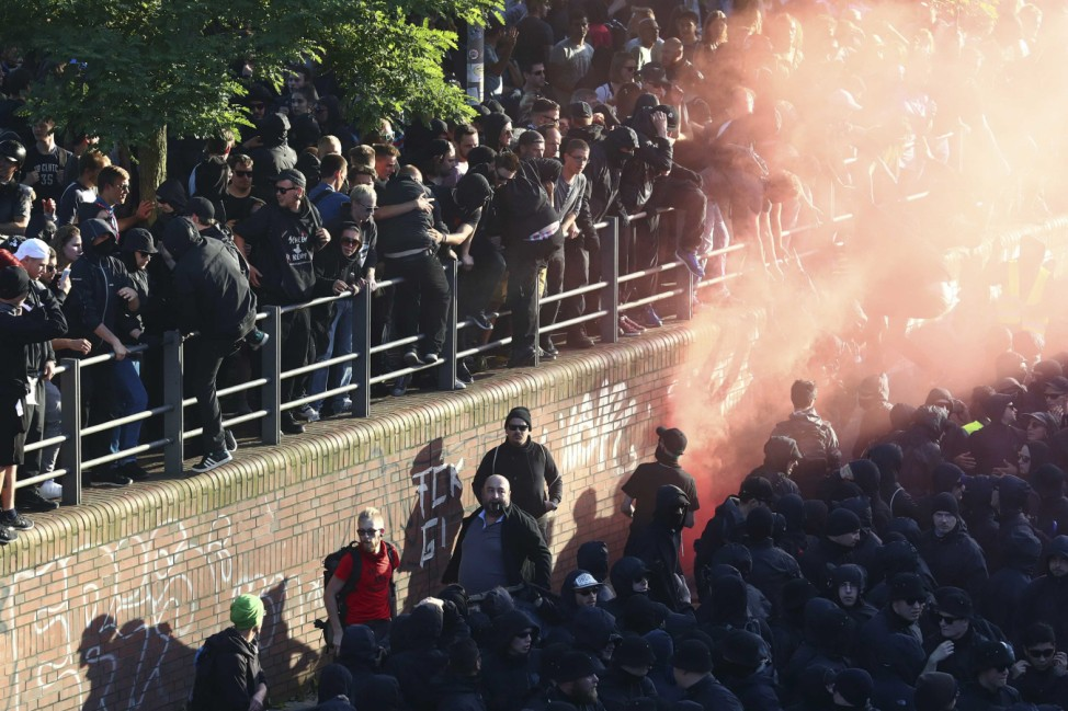 Protesters use smoke bombs during the demonstrations during the G20 summit in Hamburg