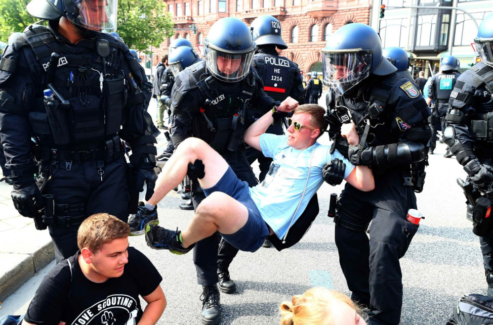 German police remove protestors who are blocking a street at a demonstration during the G20 summit in Hamburg