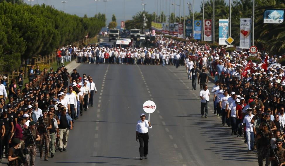 TurkeyâÄÖs main opposition CHP leader Kilicdaroglu walks on the final stage of his 25-day long protest, dubbed âÄœJustice Marchâĝ, against the detention of the partyâÄÖs lawmaker Berberoglu, in Istanbul,
