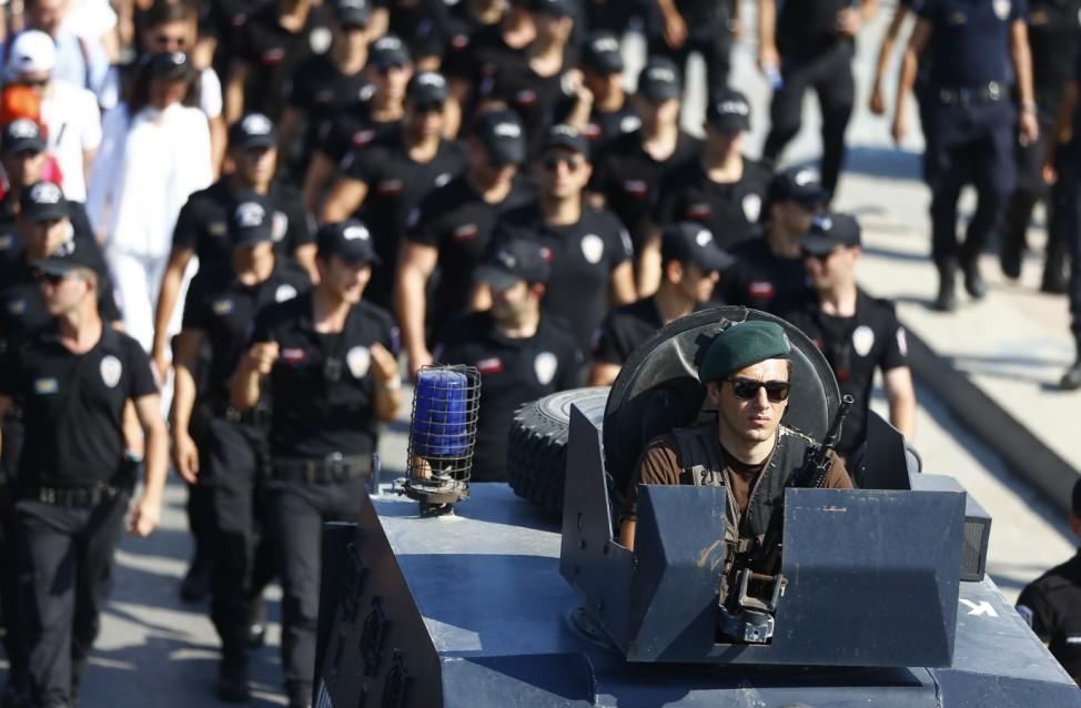 Riot police escort as TurkeyâÄÖs main opposition CHP leader Kilicdaroglu walks on the final stage of his 25-day long protest, dubbed âÄœJustice Marchâĝ, against the detention of the partyâÄÖs lawmaker Berberoglu, in Istanbul