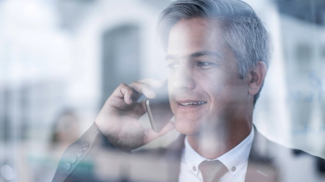 Businessman in office talking on the phone model released Symbolfoto property released PUBLICATIONxI