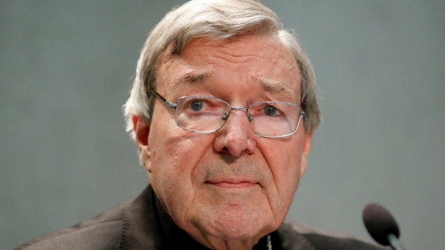 FILE PHOTO: Cardinal George Pell attends news conference at the Vatican