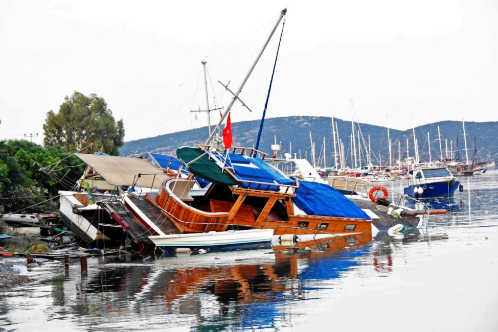 Damaged boats are seen after an earthquake and a tsunami in the resort town of Gumbet in Mugla province
