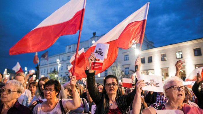 People gather during protest against Supreme Court legislation in Lublin