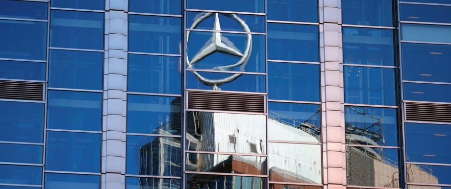 A Mercedes-Benz sign is seen reflected on a building in Warsaw