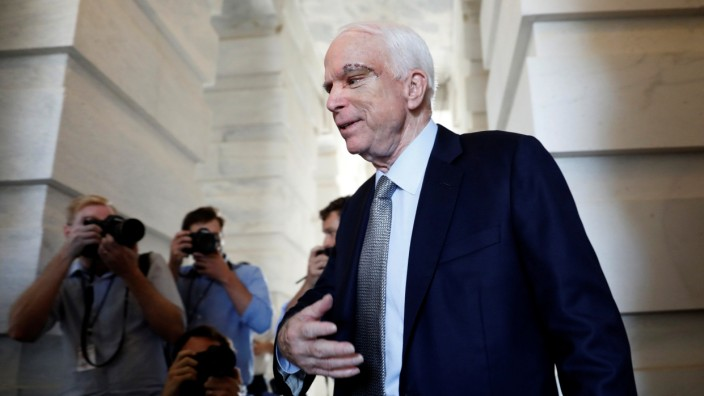Senator John McCain (R-AZ), recently diagnosed with an aggressive form of brain cancer, departs after returning to the Senate to vote on health care legislation on Capitol Hill in Washington