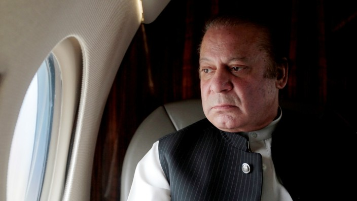 FILE PHOTO: Pakistani Prime Minister Nawaz Sharif looks out the window of his plane after attending a ceremony to inaugurate the M9 motorway between Karachi and Hyderabad