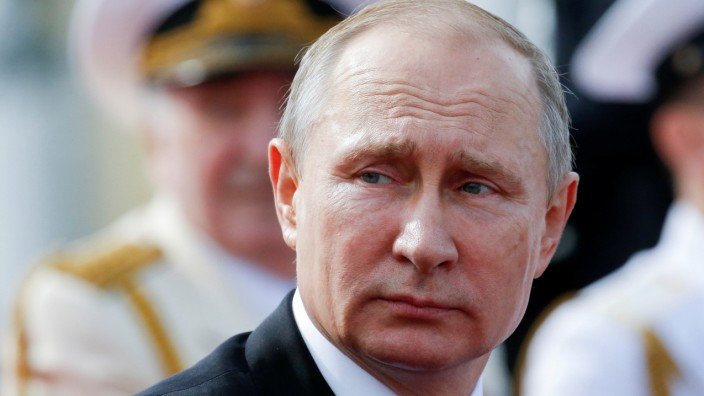 FILE PHOTO: Russian President Vladimir Putin attends the Navy Day parade in St. Petersburg