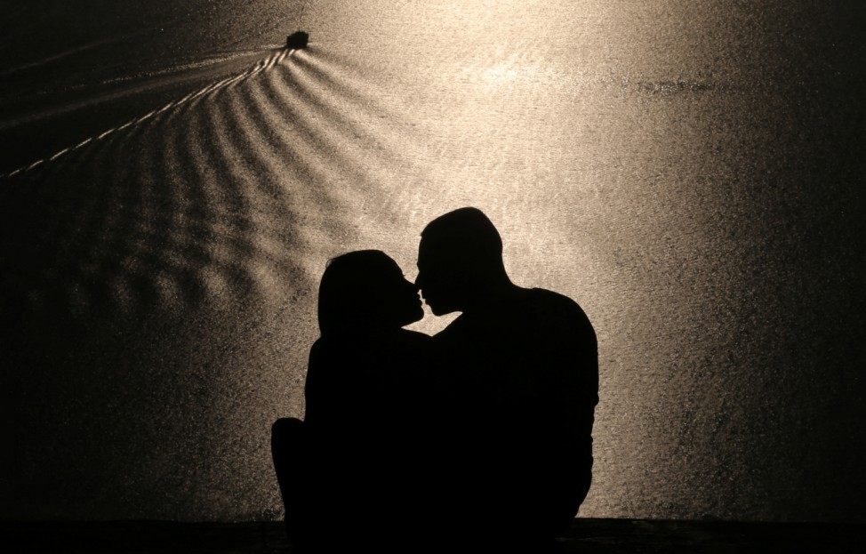 A couple kisses during sunset at Parque da Cidade or City Park in Niteroi