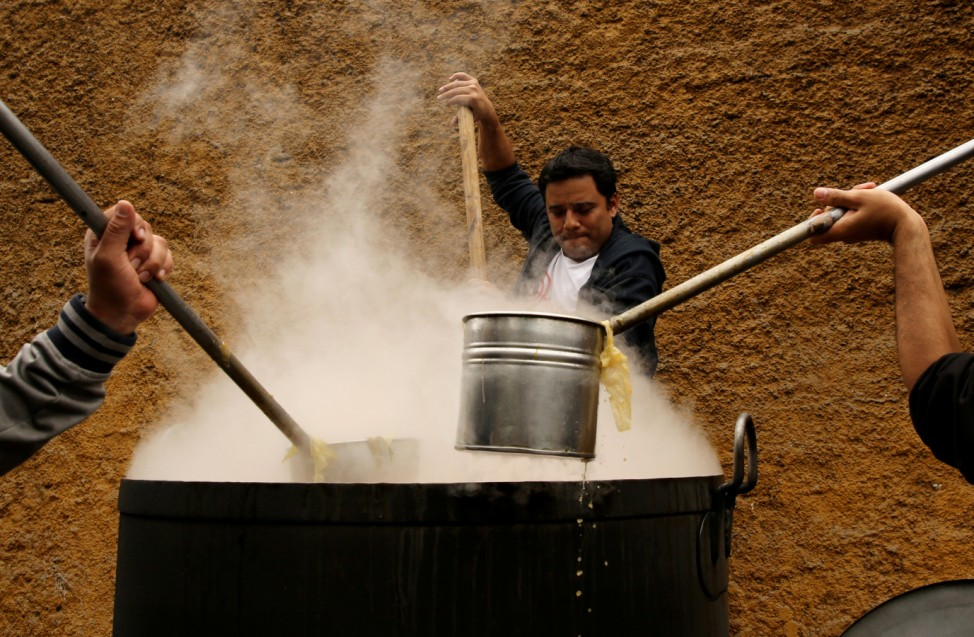 Volunteers cook soup called 'porciuncula' during La Porciuncula, a religious activity where Franciscan priests give food to people, at the convent of Los Descalzos, in Lima