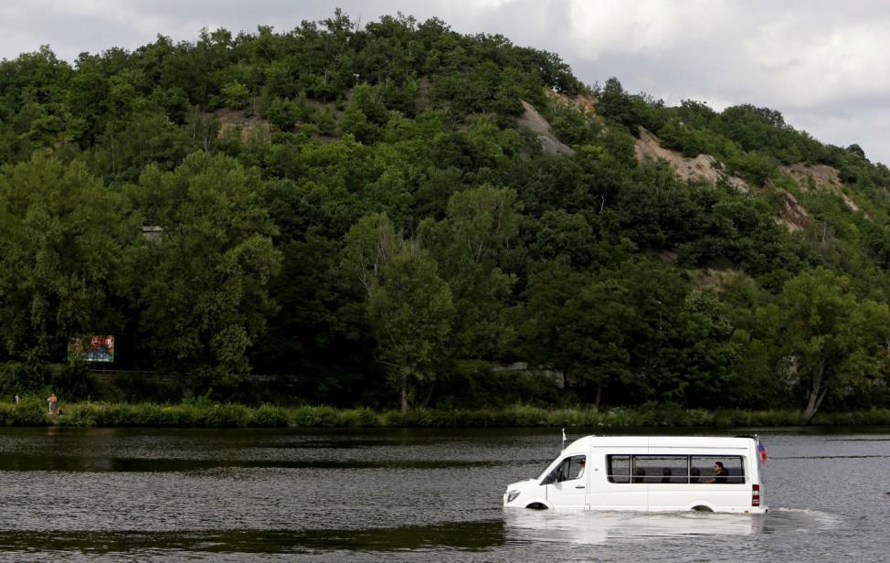 Robert Subik, a Czech constructor, drives his amphibious vehicle on the Vltava river in Prague
