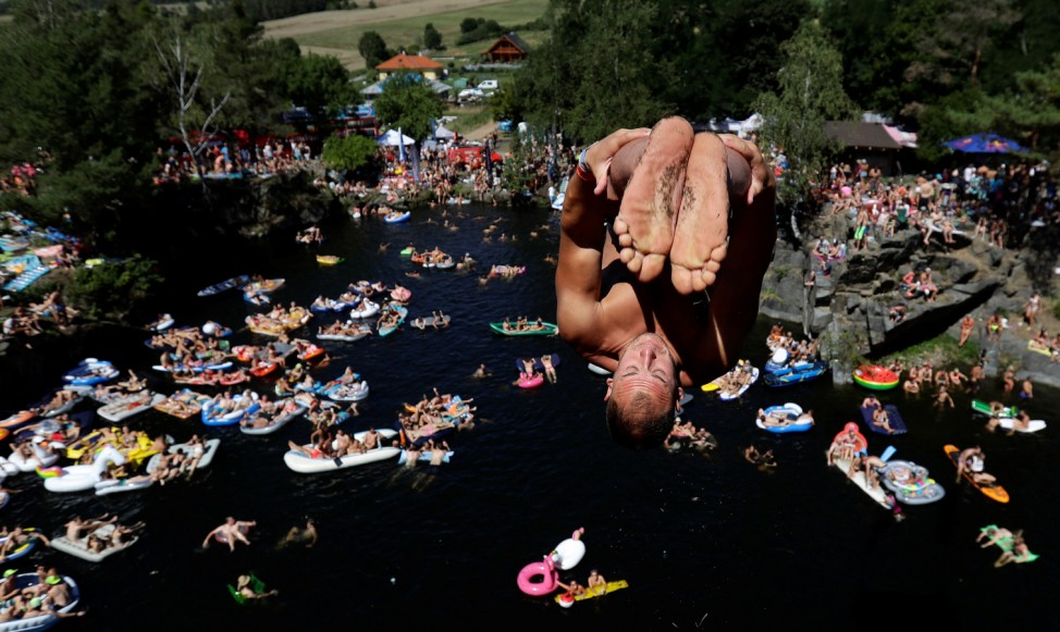 A competitor jumps into the water during a cliff diving competition near the central Bohemian village of Hrimezdice