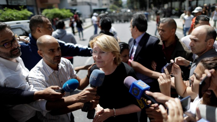 Venezuela's chief prosecutor Luisa Ortega Diaz speaks to the press during a flash visit to the Public prosecutor's office in Caracas, Venezuela