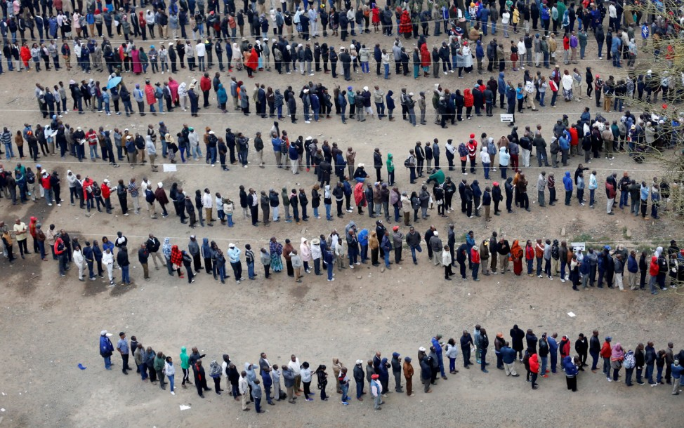 People queue to cast their vote outside a polling station in Nairobi
