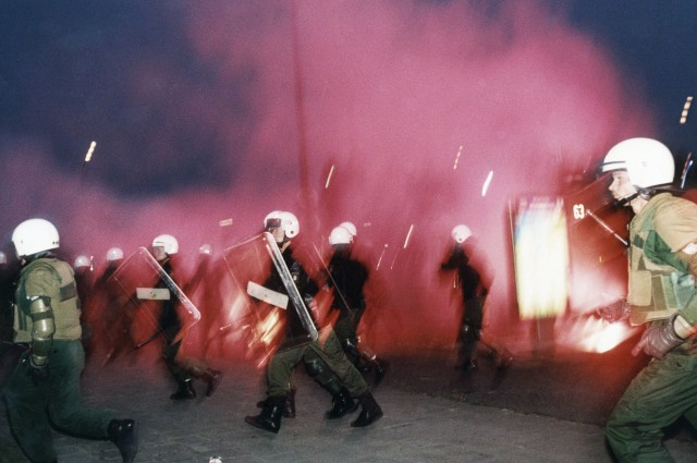 Police in riot gear run away as rightist rioters throw molotov cocktails...