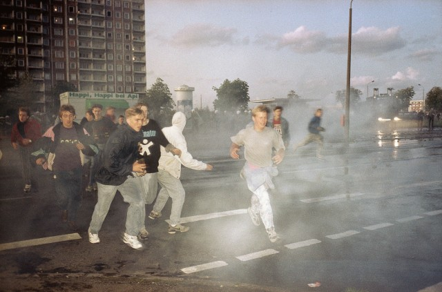 Right-wing extremists run through spray from water cannons during clashes...