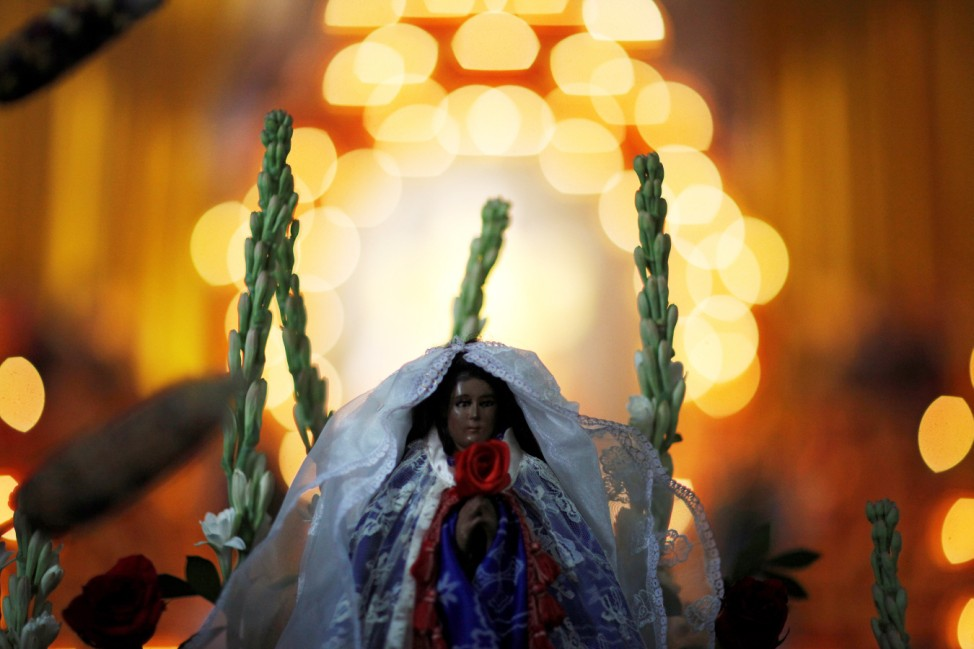 The statue of the virgin of Los Angeles known as 'Las Mariitas' is seen after a procession in its honour and as a celebration of the mother goddess Tonantzin, in Izalco