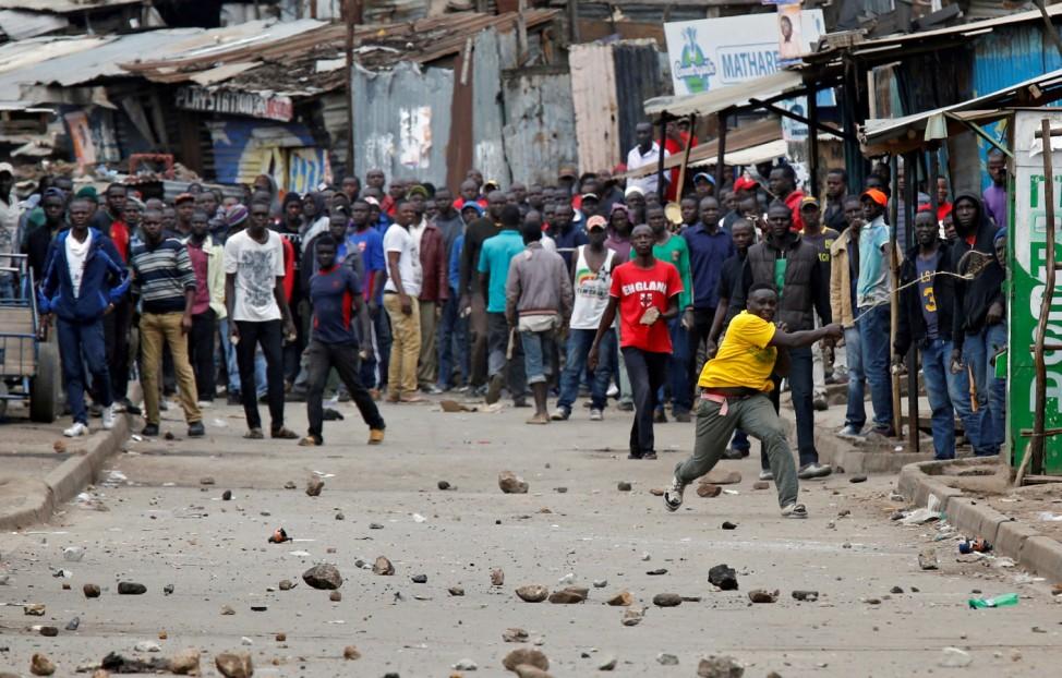 Demonstrators, supporting opposition leader Raila Odinga, throw stones in Mathare, in Nairobi