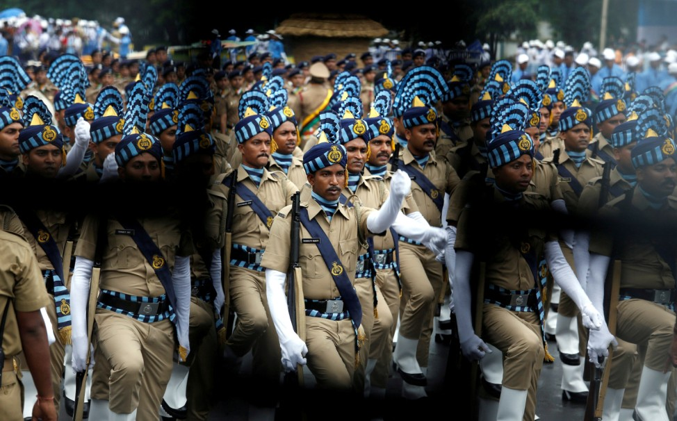 Policemen march as they take part in a full dress rehearsal for India's Independence Day parade in Kolkata