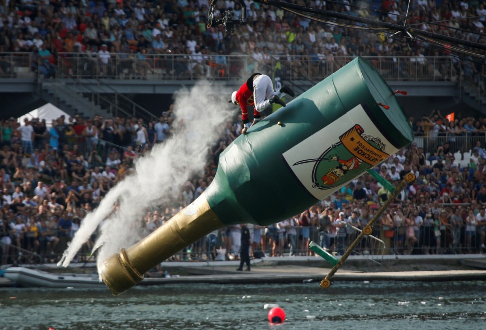 A participant from the Squadron of Flying Hussars operates a self-made flying machine during the Red Bull Flugtag Russia 2017 competition in Moscow