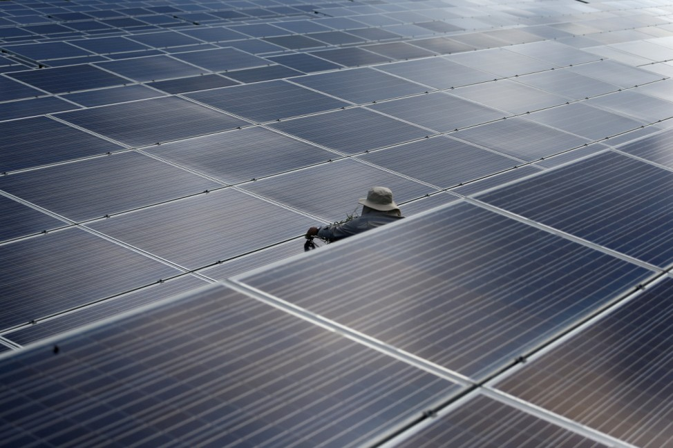 A worker works at a solar power plant by Superblock, Southeast Asia's biggest producer of solar power in Phetchaburi province