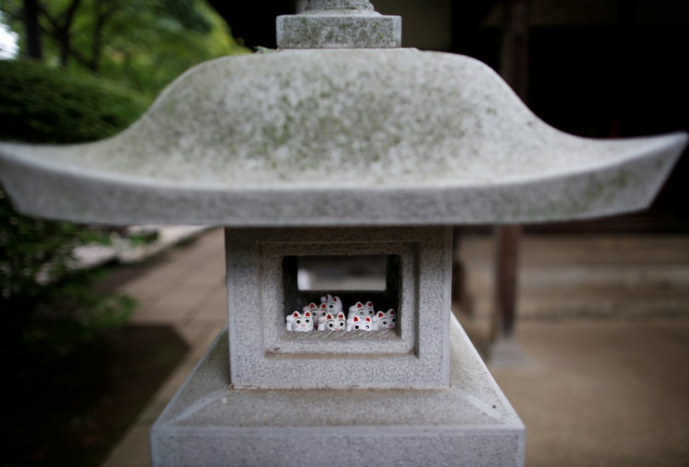 Japanese cat statues called 'manekineko', believed to bring good luck, are dedicated at Gotokuji Temple in Tokyo