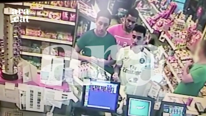 Three attackers who were shot dead in Cambrils on the night of the attack in Barcelona last week are caught on a petrol station's surveillance camera close to the town just hours before the attack, in this still frame taken from video