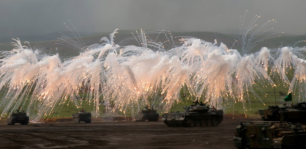Japanese Ground Self-Defense Force tanks and other armoured vehicles take part in an annual training session near Mount Fuji at Higashifuji training field in Gotemba