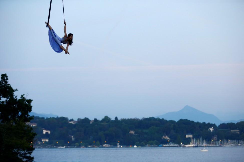 Russian acrobat Stepanova performs under a hot air balloon in Geneva