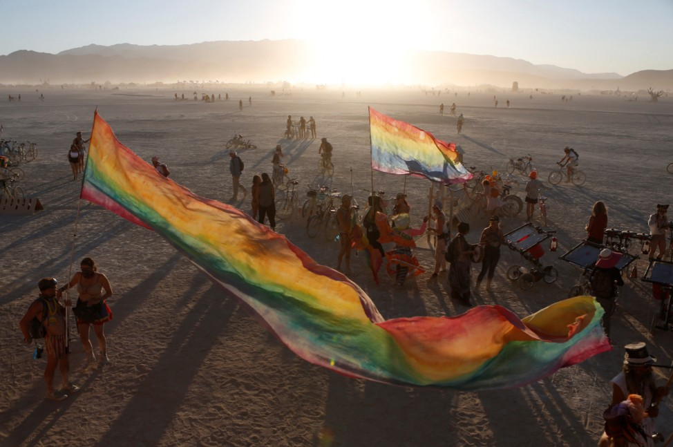 The sun sets on the playa as approximately 70,000 people from all over the world gathered for the annual Burning Man arts and music festival in the Black Rock Desert of Nevada