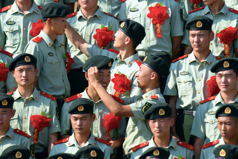 Retiring paramilitary policemen prepare for a group photo before retirement in Nanjing