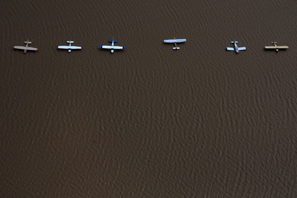 Planes are surrounded by flood waters caused by Tropical Storm Harvey at the West Houston Airport in Texasacuate neighborhood left flooded by Tropical Storm Harvey in West Houston
