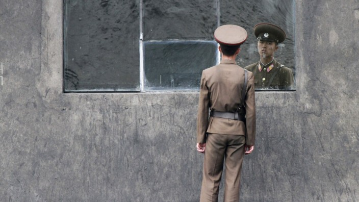 A North Korea soldier stands in front of a window along the banks of Yalu River near the North Korean town of Sinuiju, opposite the Chinese border city of Dandong; C183B95A-D313-4C4E-8664-5FAB8BB91E72
