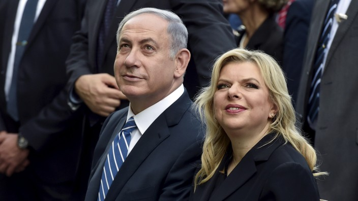 File picture shows Israel's Prime Minister Netanyahu sitting next to his wife Sara during a visit at the Expo 2015 global fair in Milan
