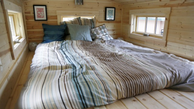 The loft bedroom of a Tumbleweed brand Cypress 24 model Tiny House is seen on display in Boulder