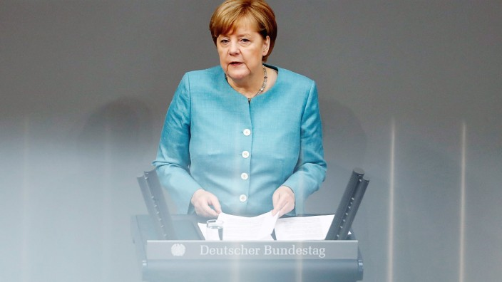 German Chancellor Merkel addresses a session at the lower house of parliament Bundestag in Berlin
