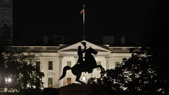 The statue of U.S. President Jackson is silhouetted against the White House in Washington