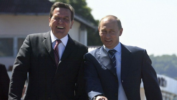 File photo of Russian President Putin and German Chancellor Schroeder; File photo of Russian President Putin and German Chancellor Schroeder
