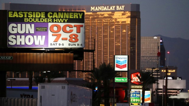A sign advertising a gun show is seen on the Las Vegas Strip in front of the Mandalay Bay Resort and Casino near the Route 91 music festival mass shooting in Las Vegas