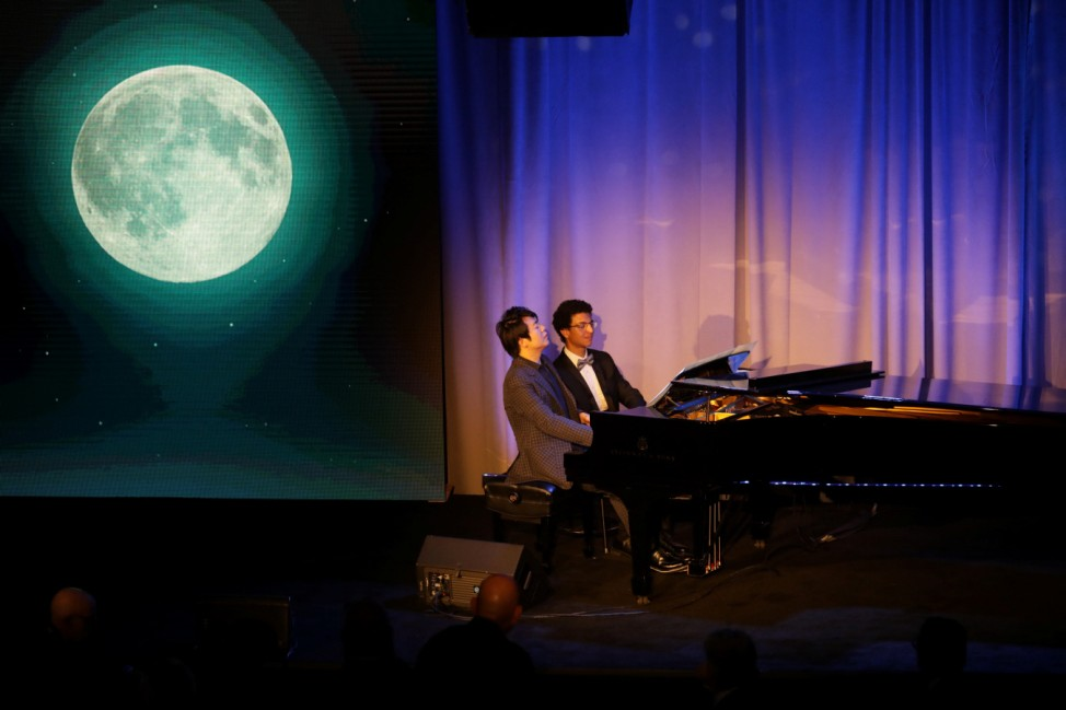 Pianist Lang Lang performs with one of his students after receiving the Global Citizen Award at an Atlantic Council event in New York, U.S.